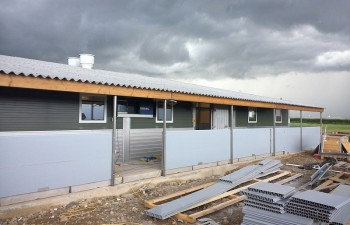 Outside view: 50mm PVC, 80mm wall panels building,  matching profile PVC and stainless steel, stainless steel bottom, door stainless steel both sides, insulated glass windows 800mm x 800mm, fibre cement roof sheets, 225 x 75 treated timber, ventilation chimneys, stainless steel supports.